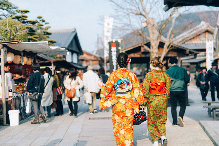Rear View Of Woman In Kimono Walking At Market