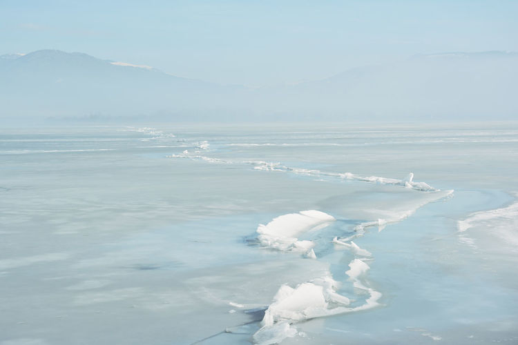 Huge crack in the surface of the frozen lake orestiada in kastoria , greece