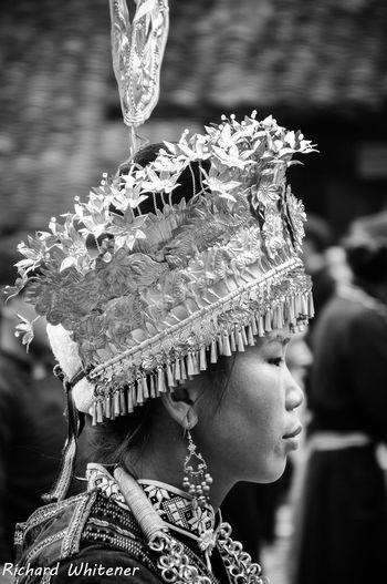 Miao Minority woman in Traditional Headdress Miao Minority Adult Close-up Clothing Day Headdress Headshot Headwear Human Representation Lifestyles Real People Side View Traditional Clothing Women