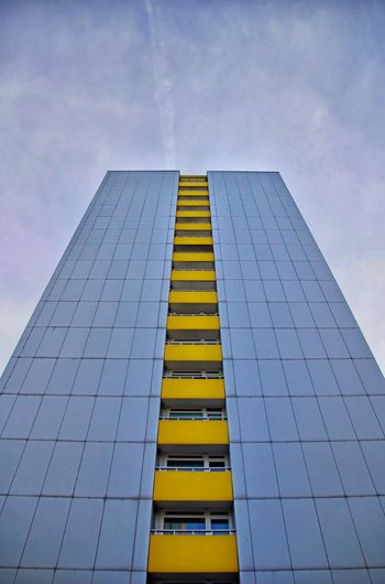 Skyscraper with yellow balconies in the centre of Berlin, Germany. Architecture Balcony Berlin Blue Building Building Exterior City City Life Cityscape Cityscapes Clouds Cloudy Cloudy Sky Daylight Gray Grey Sky Sky And Clouds Skyscraper Skyscrapers Symmetrical Symmetry Tiles Windows Yellow Paint The Town Yellow