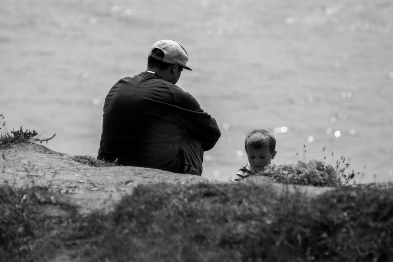 Chilling with my son. Family Rear View Grass One Person Outdoors Only Men Adult Adults Only People Day Lieblingsteil Abstract Photography EyeEmNewHere Nature Focus On Foreground Black And White B&W Magic Miles Away EyeEm Gallery Welcome To Black Long Goodbye Break The Mold Live For The Story Let's Go. Together.