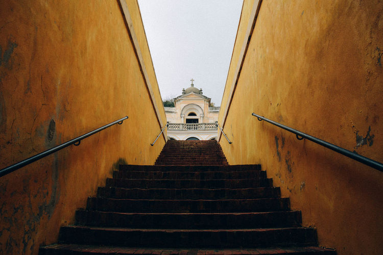 Low angle view of staircase leading to church