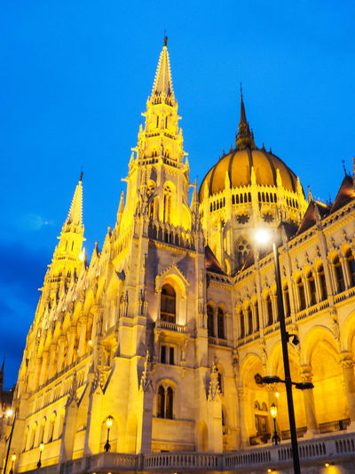 Architecture Building Exterior Night Low Angle View Built Structure Travel Destinations Religion Business Finance And Industry Sky Outdoors No People Yellow Illuminated Politics And Government Budapest Vengria Danube River Hungary Dunay River City Parliament Building Parliament Hungarian Parliament