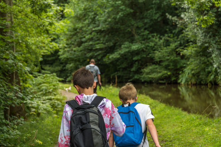 boys hiking along the canal river with backpacks on. Green Hiking Nature Tree Backpack Boys Bushes Child Childhood Day Ellesmere Lake Forest Friendship Lake Males  Nature Outdoor Photography Outdoors Outdoors Photograpghy  People Rear View Togetherness Tree Water Waterfront