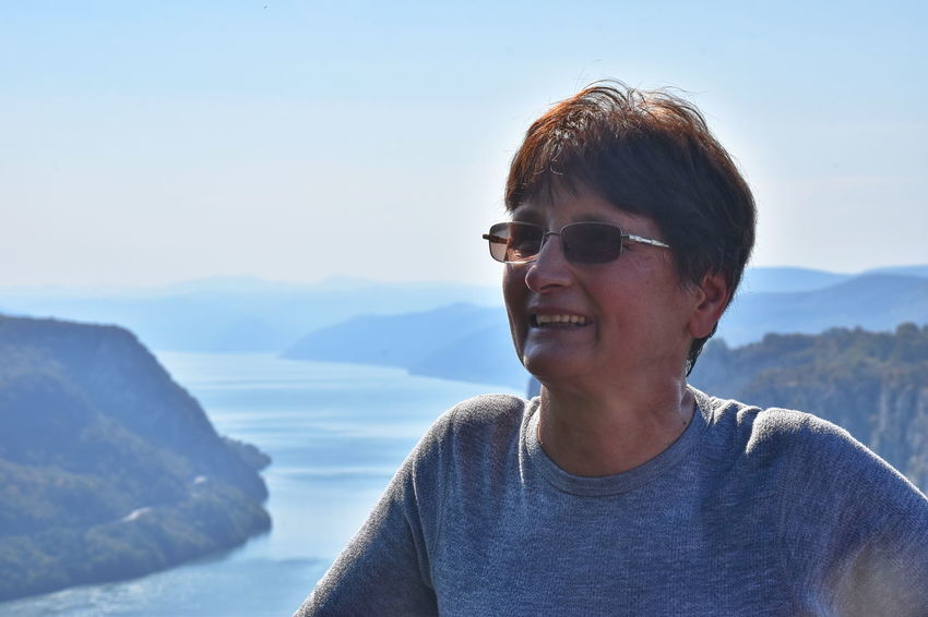 Danube gorge, Serbia Lifestyles Leisure Activity One Person Real People Headshot Glasses Portrait Casual Clothing Front View Sky Day Scenics - Nature Smiling Mountain Water Mountain Range Outdoors River Focus On Foreground Woman Mature Adult