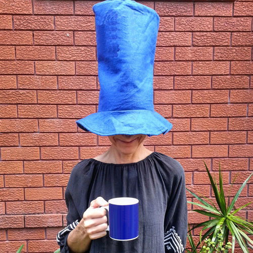 what's under the hat is what matters most Don't Be Square EyeEm Best Shots From My Point Of View Fun Hat Standing The Week on EyeEm Blue Brick Wall Coffee - Drink Coffee Cup Cup Day Drinking Enjoying Life From Where I Stand Holding One Person One Woman Only Only Women Outdoors People Relax Top Hat Women