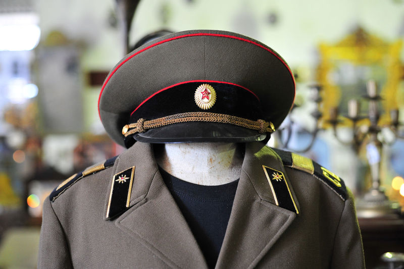 Close-up of police uniform on mannequin at store