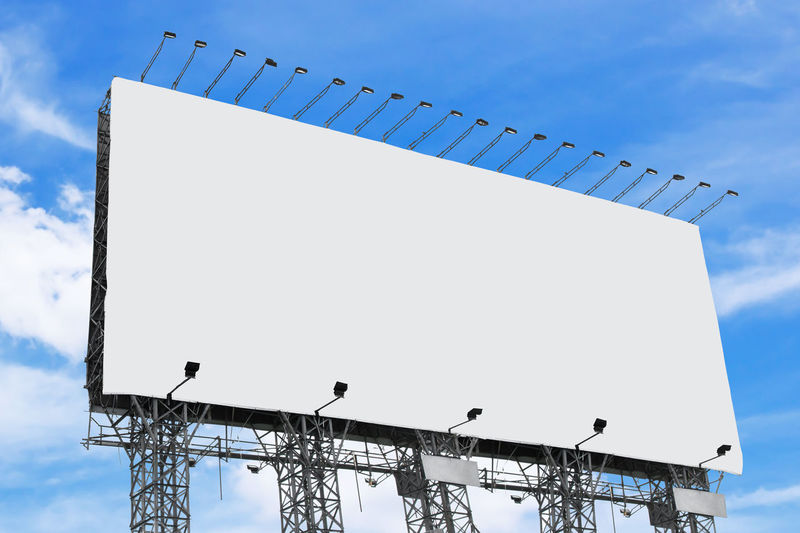Low angle view of empty billboard against sky