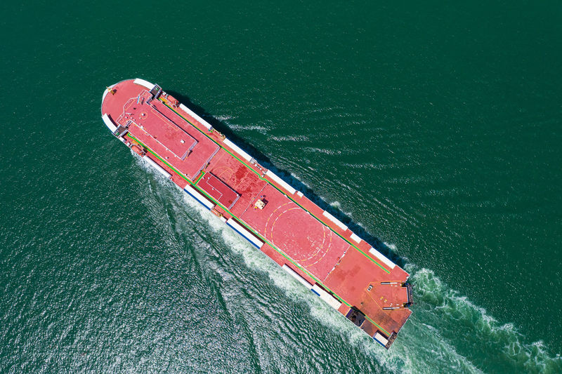 Aerial view of the huge ro-ro ship loading new cars. automotive container carriers sailing
