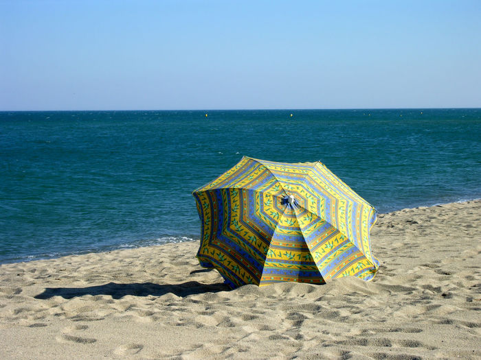 Strand Beach Beauty In Nature Clear Sky Day Horizon Over Water Mittelmeer Mittelmeerfeeling Nature No People Outdoors Protection Sand Schutz Sea Sky Sonnenschirm Vacations Water Yellow