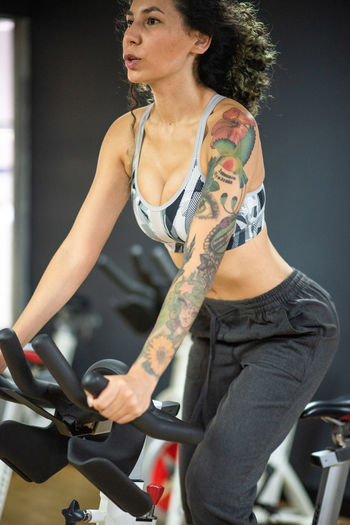 Midsection of woman riding bicycle