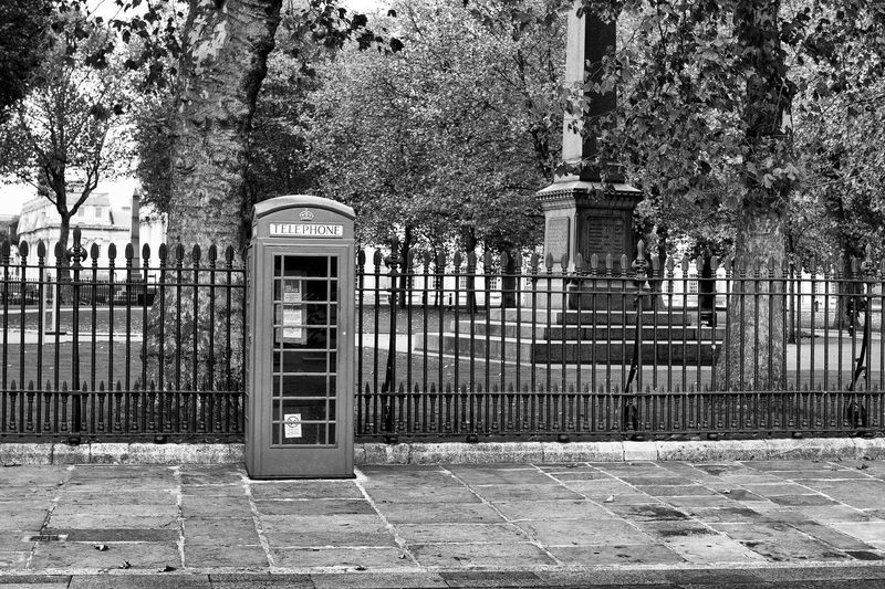 London Postcode Postcards Architecture Building Exterior Built Structure Day No People Outdoors Pay Phone Sky Telephone Booth Tree