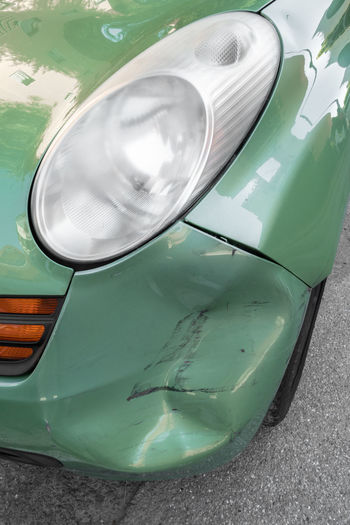Outdoor Accident Auto Automobile Background Bent Body Bodywork Broken Business Car Clash Closeup Collision Color Concept Cracked Crash Crumpled Crush Damage Danger Dent Front Green Headlight Impact Insurance Metal Orange Repair Retro Rust Rusty Safety Silver  Steel Transport Transportation Vehicle Vertical