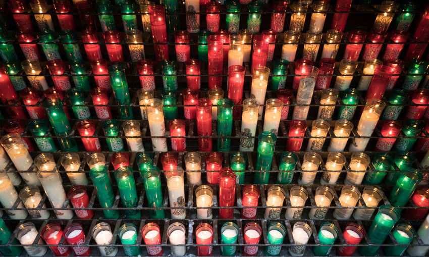 Rows of burning sacrificial candles in different colours Belief Flame Illuminated Memorial Pattern Prayer Radial Religious  Spirituality