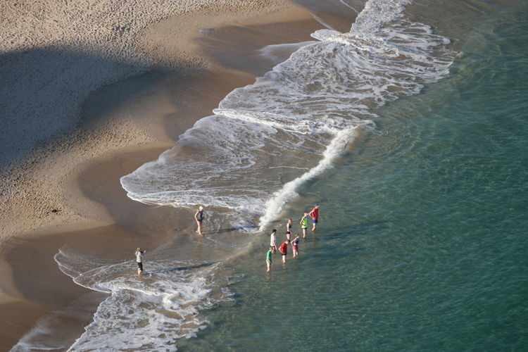 High angle view of people on shore at beach