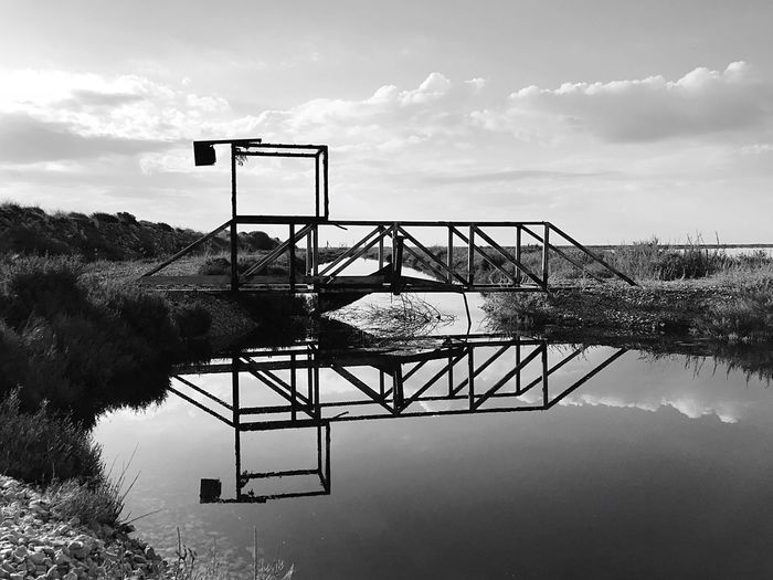 Abandoned Metal Structure Bridge River Sky Water Nature Cloud - Sky Architecture Built Structure No People Reflection Outdoors Tranquility Silhouette Standing Water