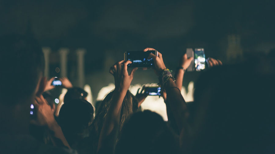 People Recording Concert With Mobile Phones
