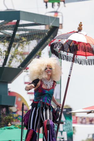 Costa Mesa, CA, USA - July 14, 2017: Theatrical circus performer Megan Fontaine, part Mango and Dango, performs with Dragon Knights steampunk stilt walkers at the Orange County Fair in Costa Mesa, CA on July 16, 2016. Editorial use only. Circus Dragon Knights Entertainer Entertainers Mango And Dango Megan Fontaine OC Fair Orange County Fair Performance Performer  Theatre