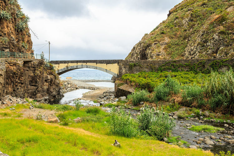 Madeira Island São Jorge Architecture Beauty In Nature Bridge - Man Made Structure Built Structure Cloud - Sky Day Grass Nature No People Outdoors River Rock - Object Scenics Sky Tree Water