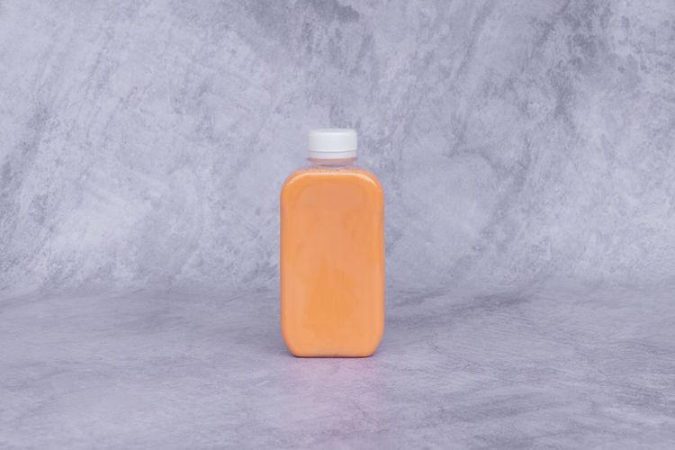 Close-up of bottle in jar