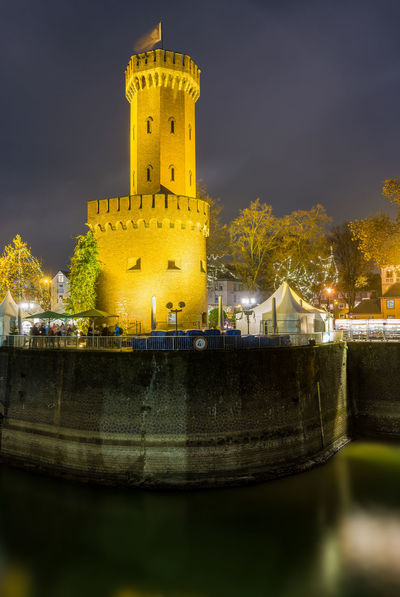 View of the illuminated Malakoff Tower at Night on the Rhine in Germany Cologne 2018. Malakoff Tower Tower Ancient Historical Building History Cologne Germany Night Long Exposure Rhine Castle Old Building Exterior Architecture Illuminated River Built Structure Water Sky Building Nature The Past Waterfront Travel Destinations Reflection Tree Lake Outdoors