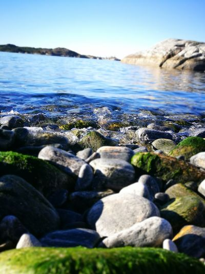 Water Tranquil Scene Rock - Object Sunlight Nature Coastline Surface Level Flowing