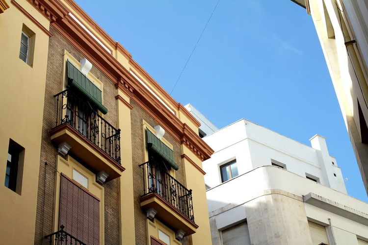 Sevilla Seville Seville Street Photography Architecture Balcony Blue Blue Sky Building Exterior Built Structure Clear Sky Day Low Angle View Nature No People Outdoors Sky Sunlight Window