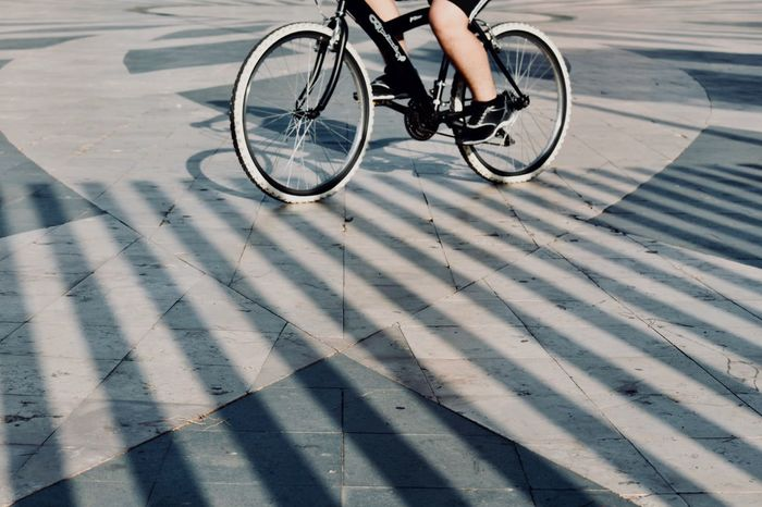 Stripes and circles... Shadows & Lights Pattern Getting Inspired Bicycle Transportation Shadow One Person Sport Cycling Low Section Lifestyles Activity Real People Sunlight Riding Ride Land Vehicle Human Body Part Street City Human Leg Day Leisure Activity