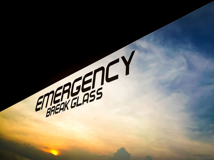 Guidance Arrow Symbol Direction Sunset Text No People Sky Outdoors Road Sign Day Close-up EyeEm Phillipines Break Glass Break Glass To Open Emergency Exit Emergency Break EyeEm Vision