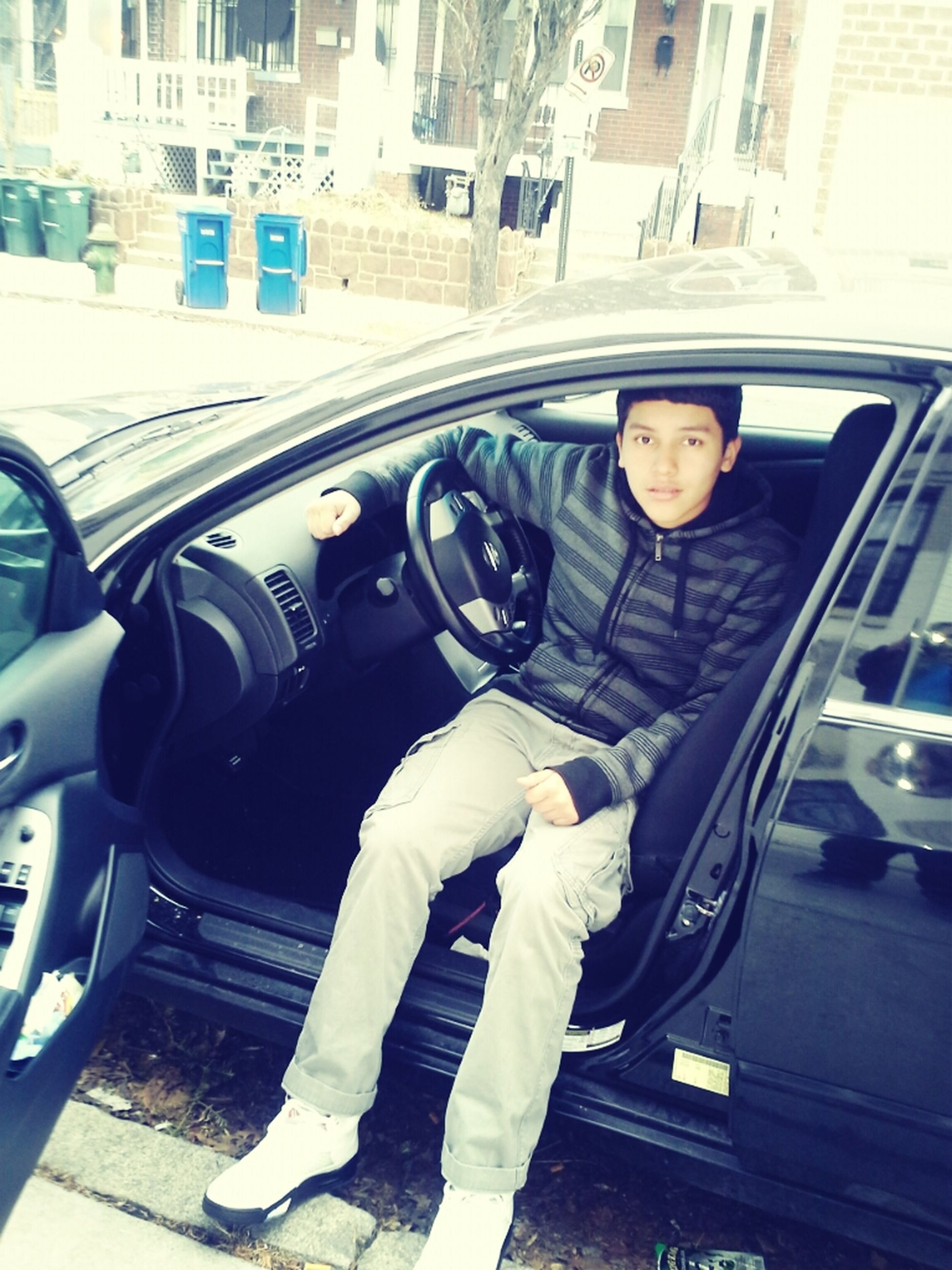 transportation, mode of transport, land vehicle, lifestyles, car, built structure, architecture, young adult, building exterior, leisure activity, casual clothing, person, street, day, front view, city, travel, standing