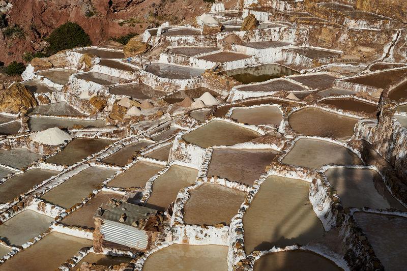 Salt ponds of maras in sacred valley of the incas, near cuzco. basins for salt production