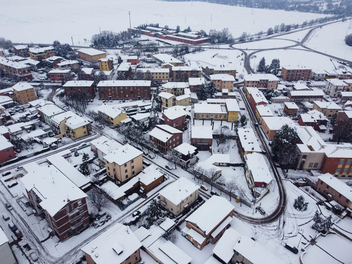High angle view of snow covered buildings in town