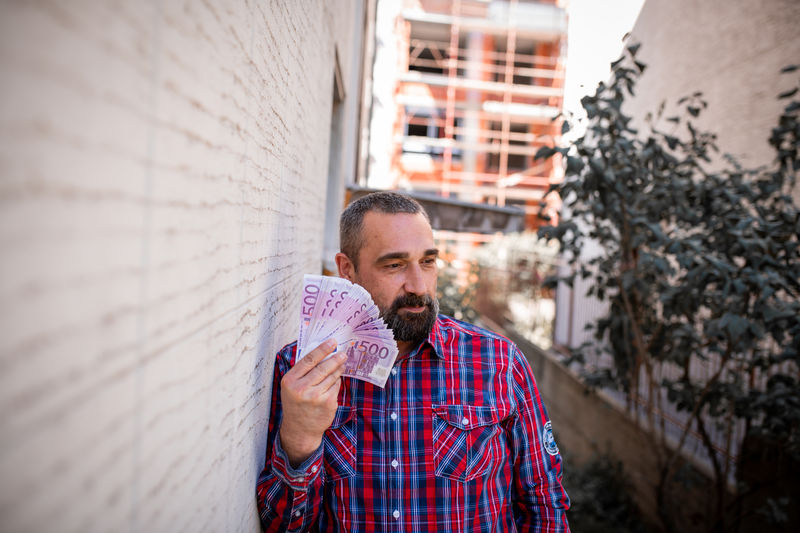 Portrait of man holding currency