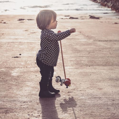 Enjoy The New Normal Outside Photography Play Learning Sea Childhood Cute Child Leisure Activity Holding Casual Clothing Wellies  Wellington Boots Scotland Children Only Beach Outdoors Fresh Air... Fresh Air And Sunshine