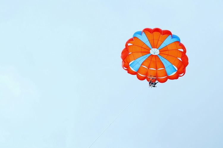 Low angle view of people in parachute