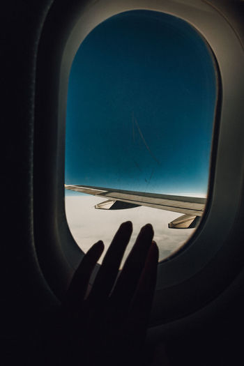 Reflection of sky seen through airplane window
