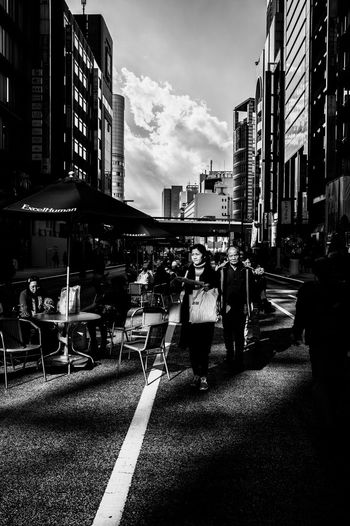 Building Exterior Architecture City Built Structure Street Real People Men Outdoors Sky Women Day Streetphotography Capture The Moment Street Photography Tokyo Street Photography EyeEm Best Shots Leicacamera Monochrome 35mm Blackandwhite
