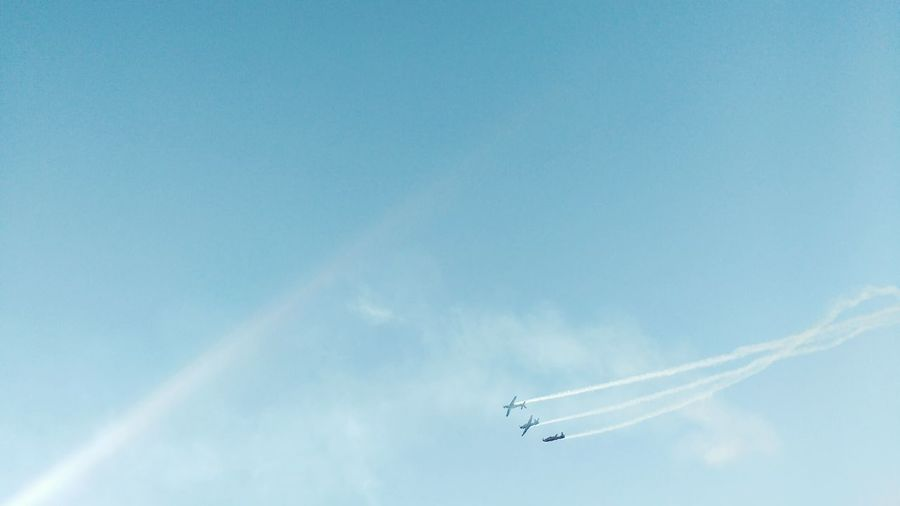 Low angle view of airshow in sky