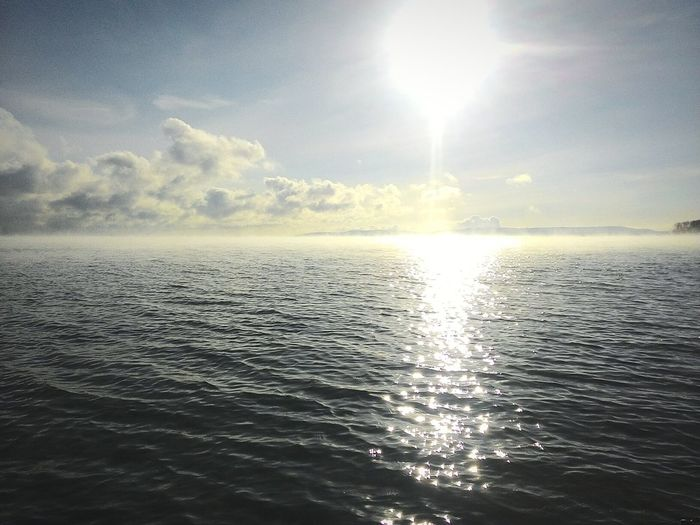 Sea Sea Reflection Sunlight Nature Beauty In Nature Water Tranquility Tranquil Scene Rippled Sunbeam Sky Sea Scenics Outdoors Idyllic Horizon Over Water Cloud - Sky Sunset No People Day