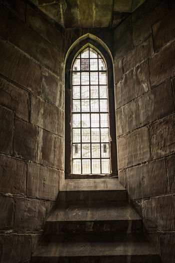 Ancient Architecture Architecture Bars Bricks Built Structure Burden Closed Closed Window  Day Dream Gothic Hope Imprisoned Indoors  Light Limited Low Angle View Lust No People Prison Religion Romanesque Spirituality Window