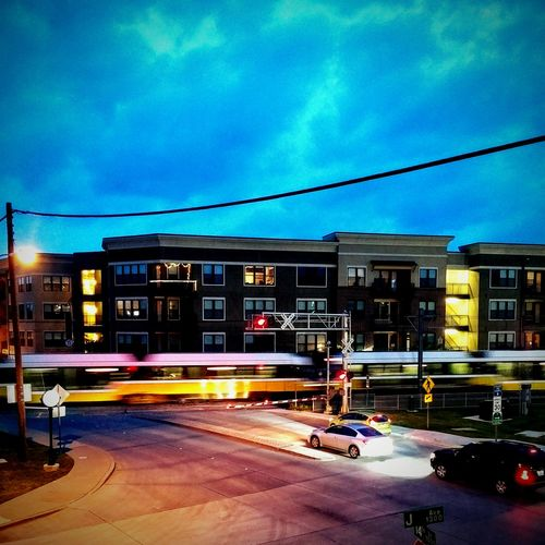 Cities At Night Train Trainphotography Rapidtransit Apartment Apartment Buildings Dusk In The City Streetphotography Railroadcrossing
