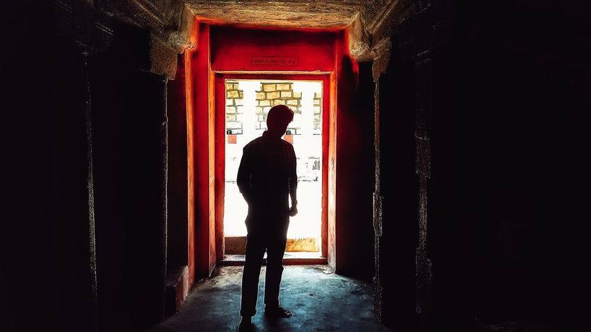 Candid Silhouette Standing Full Length Indoors  Entrance Doorway Dark Day Entryway Backlit Outline Arched Week On Eyeem Temple Architecture Temple Run 2 EyeEm Vision TakeoverContrast Color Of Business
