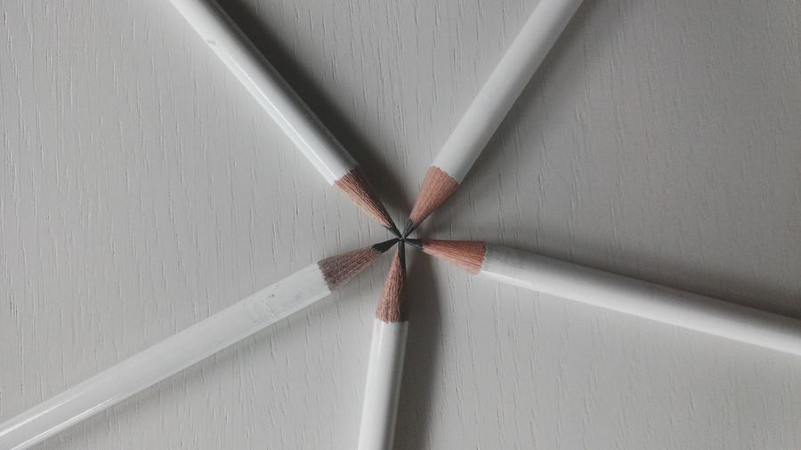 Directly above shot of pencils on white table