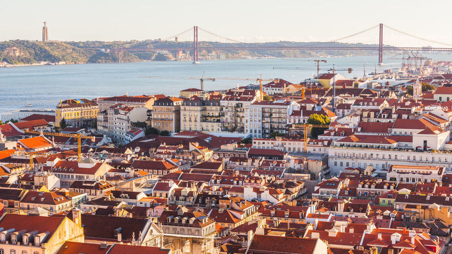 Lisbon View at Sunset EyeEmNewHere Lisbon - Portugal Lisbonlovers Portugal Architecture Bridge Bridge - Man Made Structure Building Exterior Built Structure City Cityscape Golden Hour High Angle View Lisbon Sunset Suspension Bridge Town Travel Destinations Water The Week On EyeEm EyeEm Selects Adventures In The City