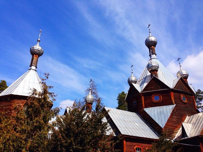 Rustic church against blue sky