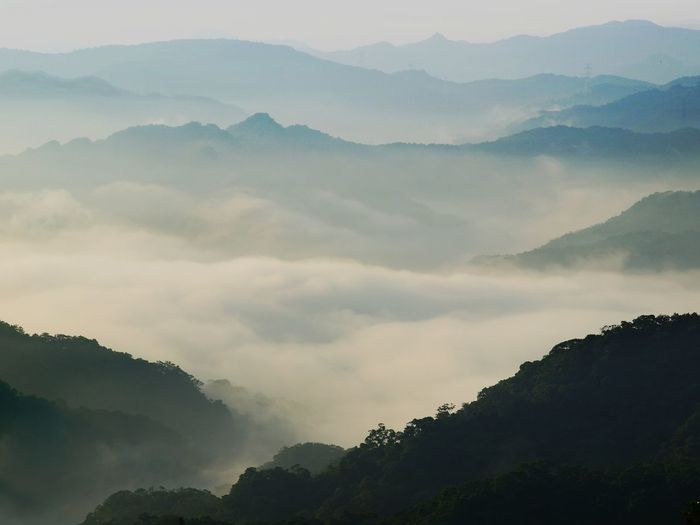 Misty valleys of New Taipei's Pingxi district, as seen from the mountain road connecting Pingxi with Xizhi district, early morning. Taiwan Beauty In Nature Day Fog Forest Hazy  Idyllic Landscape Mist Misty Valleys Mountain Mountain Range Nature No People Outdoors Pingxi Scenics Tranquil Scene Tranquility
