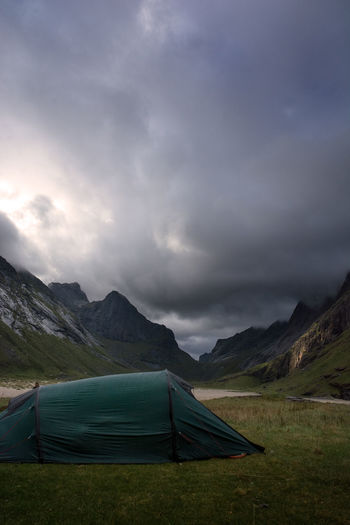 Mountain Sky Tent Cloud - Sky Scenics - Nature Camping Landscape Nature Environment Beauty In Nature Mountain Range No People Non-urban Scene Tranquility Tranquil Scene Green Color Land Storm Field Outdoors Ominous Lofoten Beauty In Nature