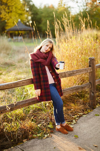 Adult Adults Only Beautiful Woman Blond Hair Casual Clothing Day Front View Full Length Grass Jeans Leisure Activity Looking At Camera Nature One Person One Woman Only One Young Woman Only Only Women Outdoors Portrait Rural Scene Smiling Standing Women Young Adult Young Women