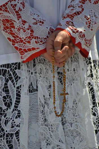Midsection Of Priest Standing With Rosary Beads