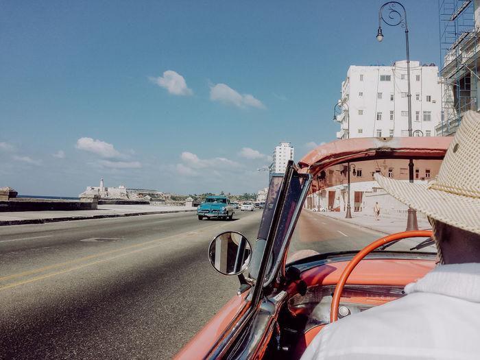 Havana, Cuba The Traveler - 2018 EyeEm Awards Been There. Cars City Cuba Havana Malecon Old-fashioned Taking Photos Walking Around Architecture Building Exterior Built Structure Car City Eye4photography  Land Vehicle Outdoors Street Street Photography Streetphotography Transportation Travel Destinations Urban Vintage Vintage Cars
